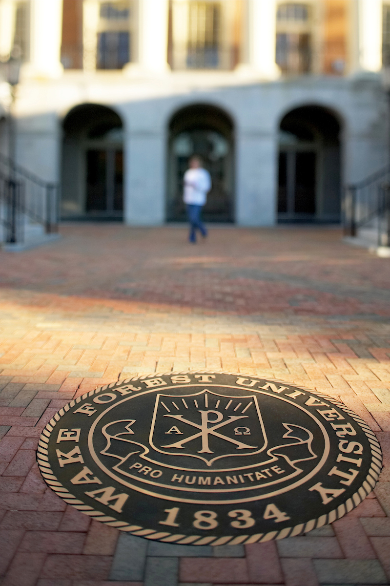 The Seal of Wake Forest University inset in the new brick walkway in front of Reynolda Hall on the Quad.