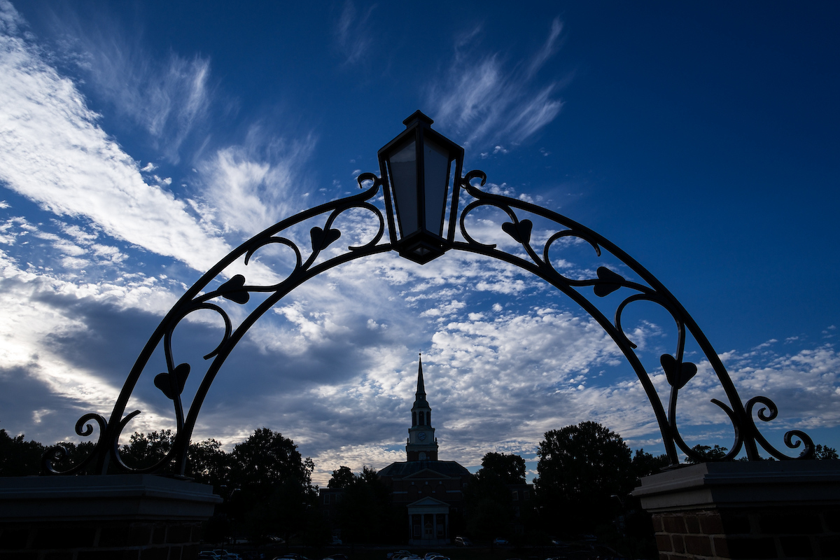 The bell tower of Wait Chapel and an arch on north campus are silhouetted against the morning sky on Monday, September 30, 2013.