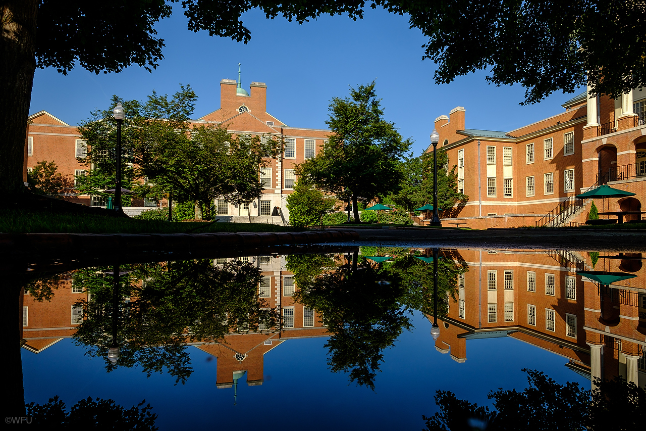 The Z. Smith Reynolds Library is reflected in a puddle on the campus of Wake Forest University on Friday, June 3, 2016.