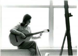 Patricia Dixon with a guitar.
