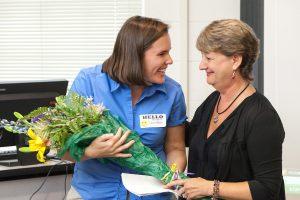 Mary Lynn Redmond presenting an award.