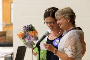 Mary Lynn Redmond presenting a teaching award.