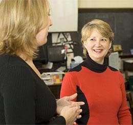 Mary Lynn Redmond speaks to a woman.