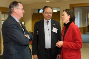 President Hatch is on the left with a conference attendee in the center and Professor Ulrike Wiethaus on the right.