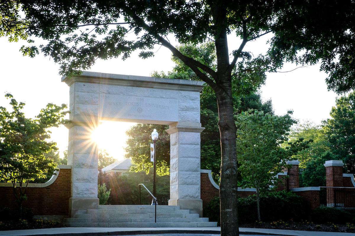 Sun shines through stone arch on Hearn Plaza