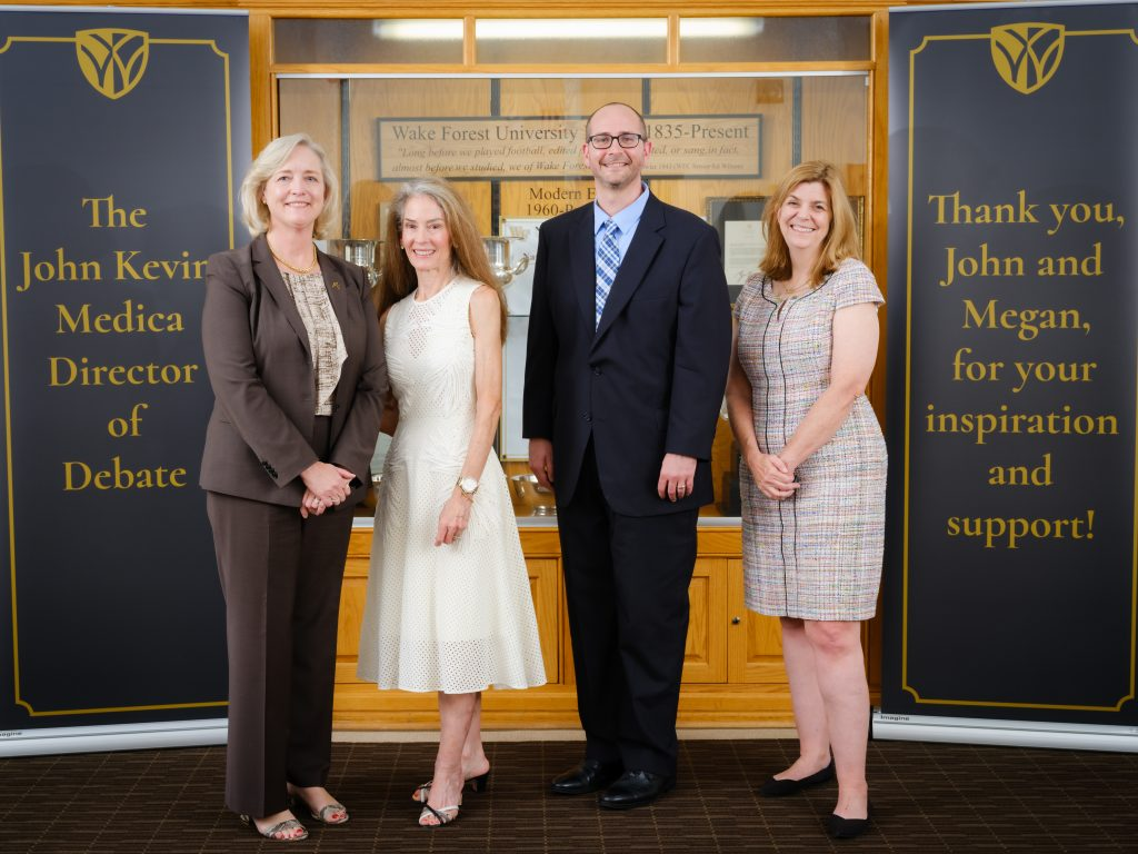 A group photo of President Susan R. Wente, Megan Medica, Jarrod Atchison, and Michele Gillespie.