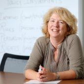 Professor Katy Harriger sits at a table at Wake Washington