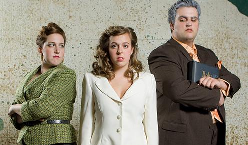 Seniors Claire Vasile as Mrs. Celia Peachum (far left) and Tony DeMartino as Jonathan Jeremiah Peachum. Freshman Candice Dickinson plays their daughter, Polly, in