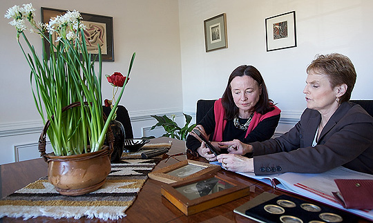 Wake Forest law professor Miki Felsenburg (right) and political science professor Helga Welsh examine the letters in Welsh's home in Clemmons.