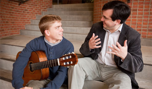 Presidential Scholar John Kossler receives some instruction from Chilean classical guitar virtuoso Carlos Perez.