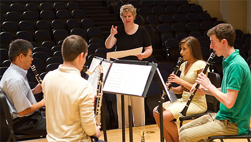 Eileen Young directs the Clarinet Quartet: Andre Nguyen (left to right), Matthew Simari, Jacob Eichhorn and Kayla Shipley.