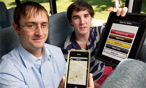 Seniors Michael Crouse, left, and Tom Loughran ride the Wake Line shuttle bus as they display their new iPhone and iPad application that tracks the shuttle in real time using GPS technology.