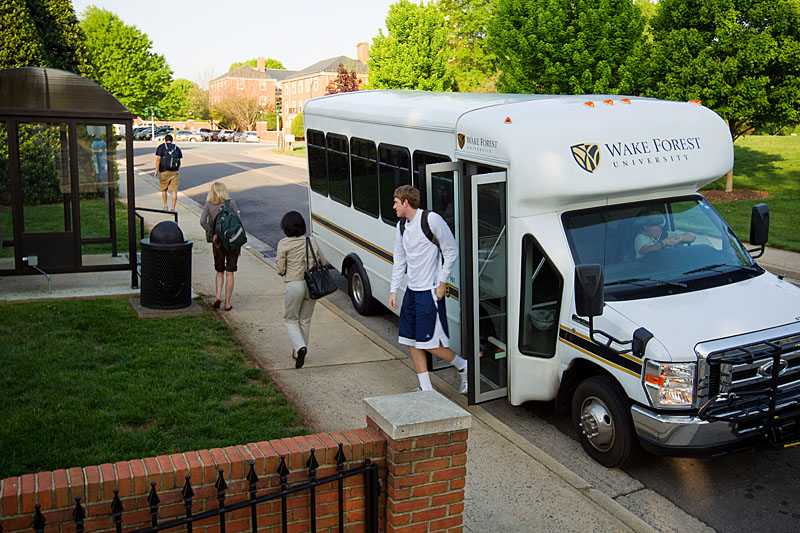 Wake Forest students ride one of the new campus shuttle buses.