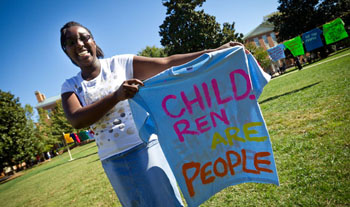 First-year student Dorronda Bordley holds up the t-shirt she painted.