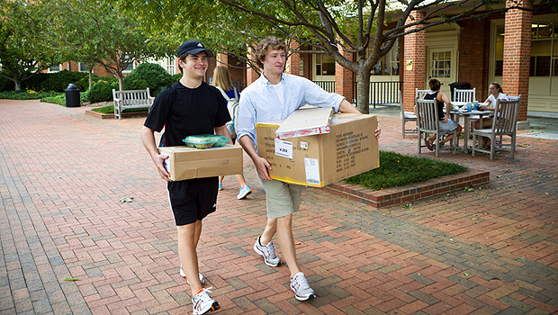 Students walking with packages