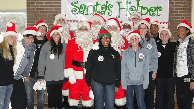 Athletes dressed as Santa