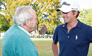 Arnold Palmer talks with Webb Simpson.