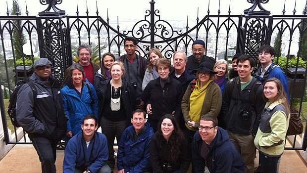 Participants in the Interfaith Pilgrimage to the Holy Land gather in front of the gates at Haifa.
