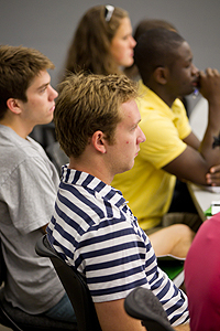 Connor Godfrey (in stripes), Gracious Addai (yellow shirt) and classmates explore future career paths in 'Options in the World of Work.'