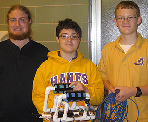 Rowland Carlson ('15) helps Hanes Magnet School students in the SeaPerch Challenge.