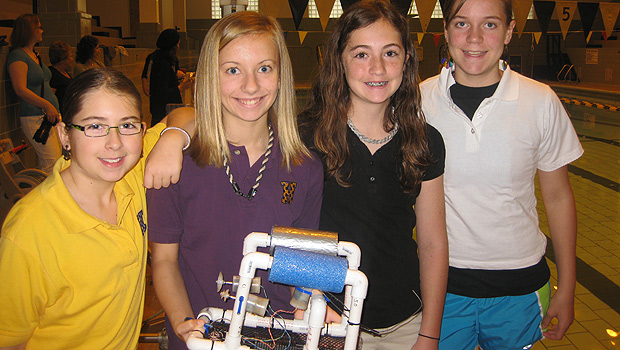 Jenna Barnes (purple shirt) and her team with their ROV just before they put it to the test.