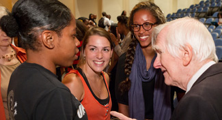 Ed Christman (right) talks with students.