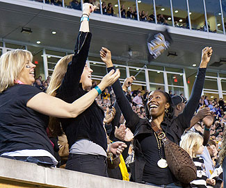Fans cheer at a Wake Forest football game.