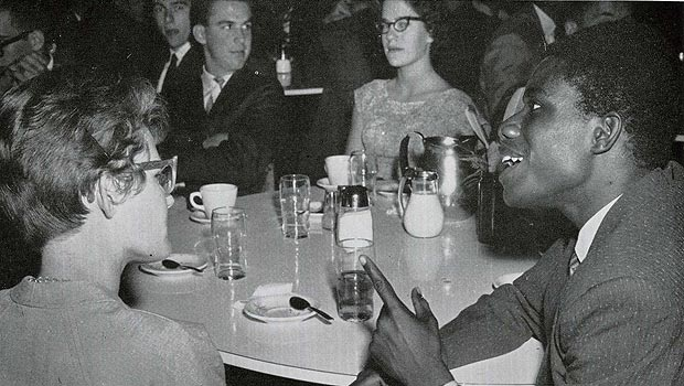Ed Reynolds talks with fellow students in 1962.