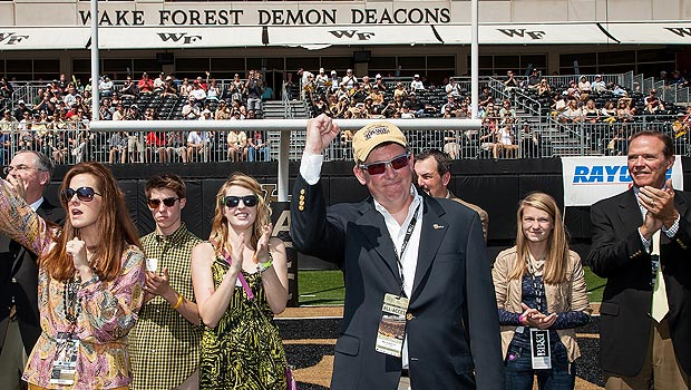 Ben Sutton Jr. and his family acknowledge the crowd after the gift was announced during the Wake Forest-Army football game.