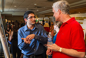 Mubhij Ahmad talks with professor Eric Carlson about his research.