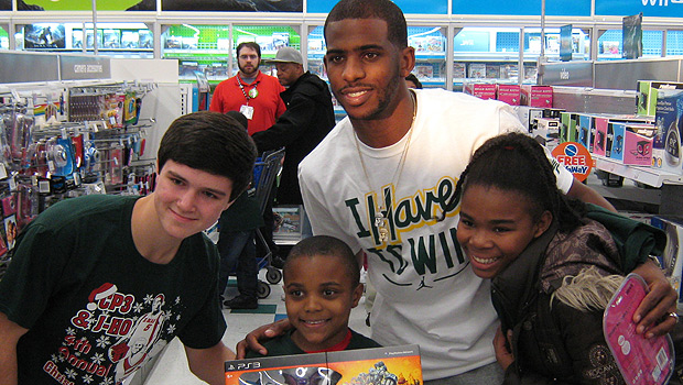 Chris Paul gives back to children at Toys R Us.
