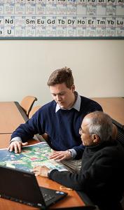 Wake Forest senior Ryan Daly ('13) talks with chemistry professor Dilip Kondepudi.