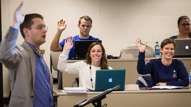 Accountancy graduate student Tori Stewart (front left, '12, MSA '13) interacts in her business ethics class taught by professor Matthew Phillips.