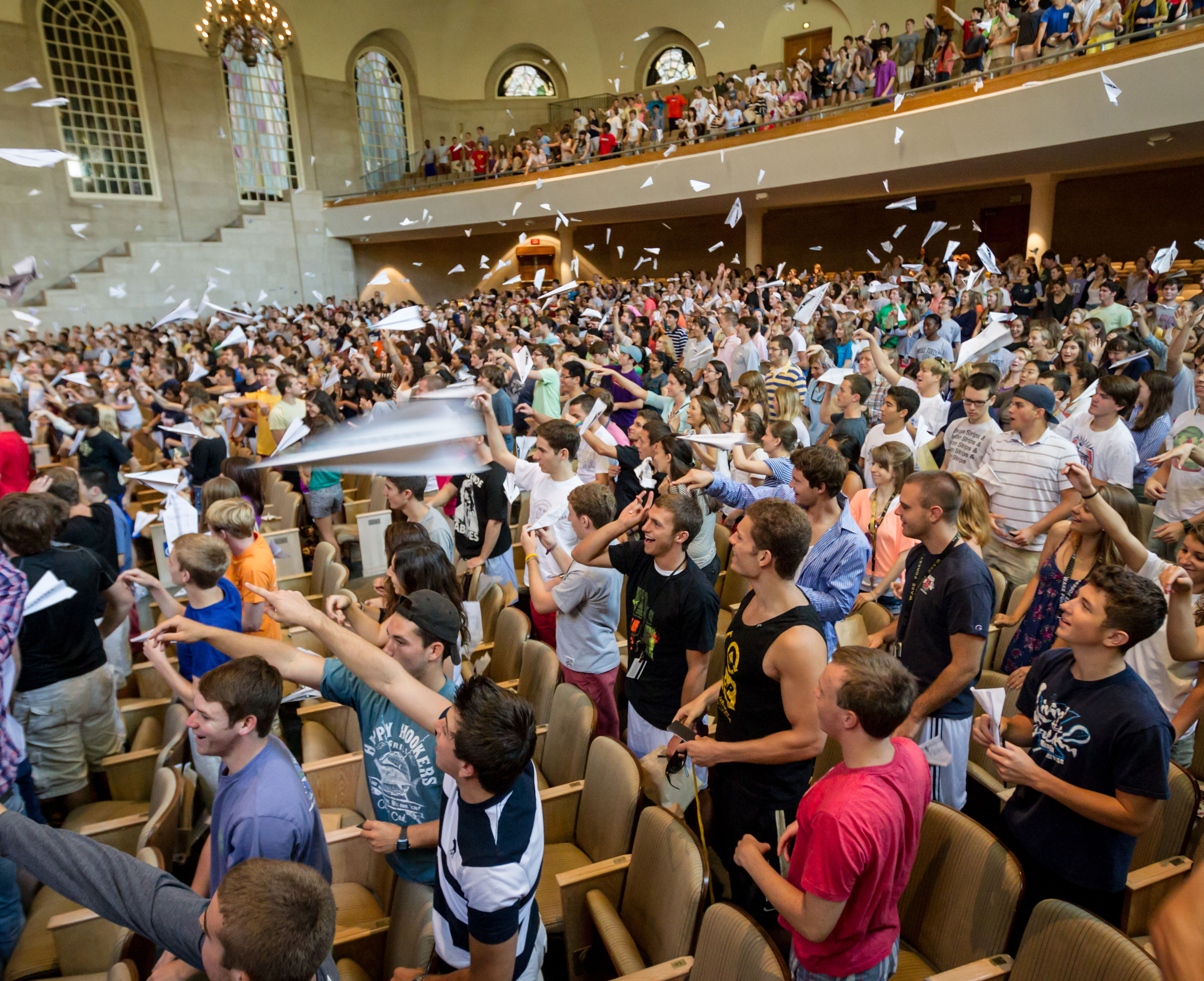 Students throwing paper airplanes in Wait Chapel