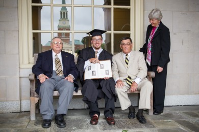 John Winslow ('13) talks with his great uncle, William Rufus Phillips ('60, MA '63), his grandfather John Dalton Phillips ('49) and his great aunt Anne Radford Phillips ('58) in front of Reynolda Hall.