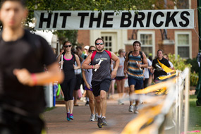Students run around the Quad during Hit The Bricks.
