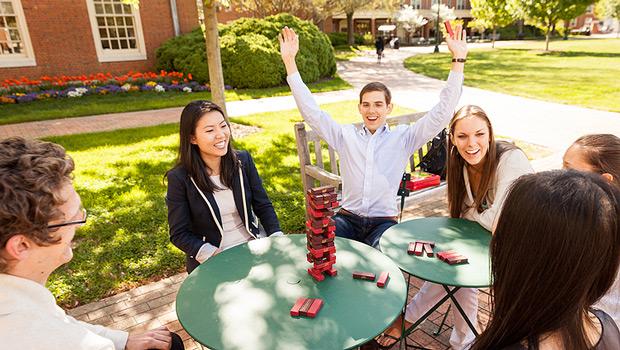 Students play Jenga on the Quad