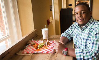 Thomas Ray, coordinator for outdoor programming initiatives, enjoys his lunch break at Zick's.
