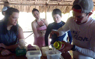 Perlman works with Wake Forest undergraduates in Belize.