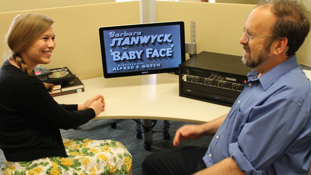 "Lizzie Woods ('14) and Scott Klein discussing the 1933 film ""Baby Face."""