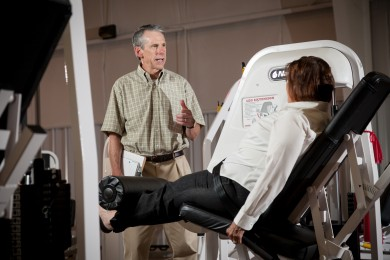Professor Steve Messier talks with START participant Kay Sages at the exercise research facility on Thursday, July 12, 2012.
