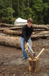 Belangia chopping firewood for Wake for Warmth.