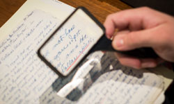 A magnifying glass can help decipher handwritten letters.