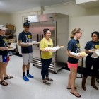 Campus Kitchen executive board members and volunteers prepare meals for local residents in its new space in Kitchin Residence Hall.