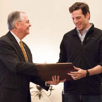 Hatch presents Beshara with the 2015 Excellence in Entrepreneurship award.