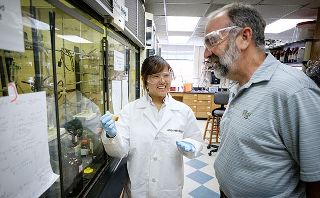Yoo with chemistry professor Mark Welker.