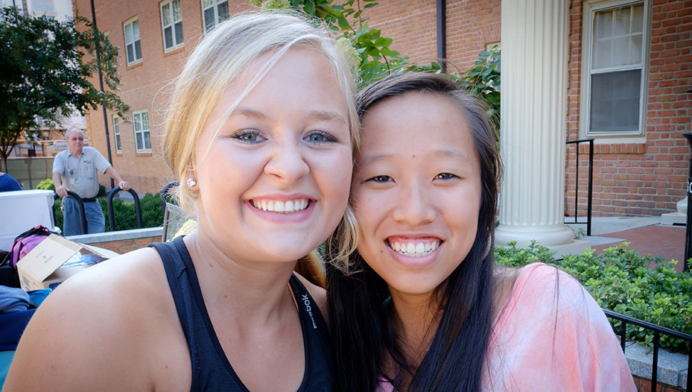 Nicole Rogers (left) meets up with her friend Celia Zhou on move-in day.