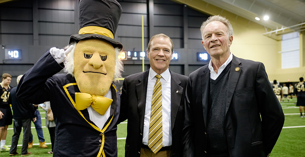 Bob McCreary (right) with AD Ron Wellman and the Demon Deacon
