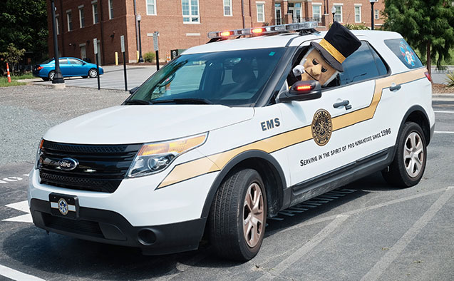 Demon Deacon riding in EMT vehicle
