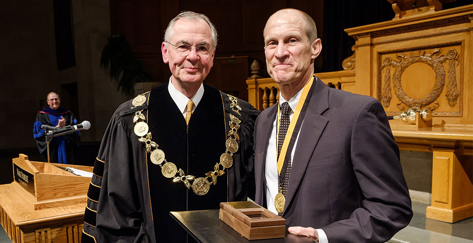Wake Forest President Nathan O. Hatch presents Medallion of Merit to Mike Ford